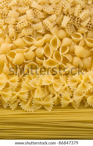 of raw pasta and spaghetti as background - stock photo