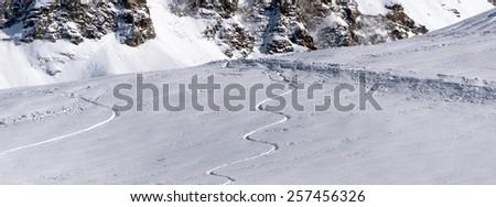 Off-piste skiing - Ski Freeride - stock photo