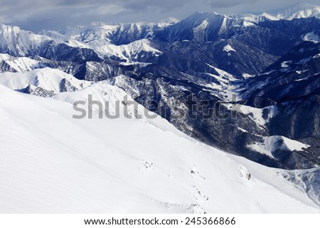 Off-piste slope and snowy mountains. Caucasus Mountains, Georgia. Ski resort Gudauri.  - stock photo