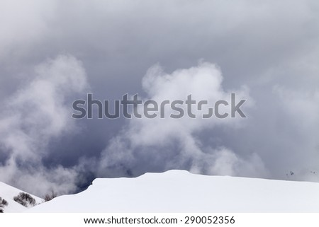 Off-piste slope in mist. Caucasus Mountains, Georgia, ski resort Gudauri. - stock photo