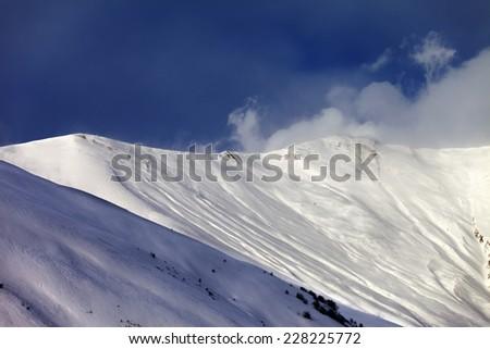 Off-piste slope in sun evening. Caucasus Mountains, Georgia, ski resort Gudauri. - stock photo