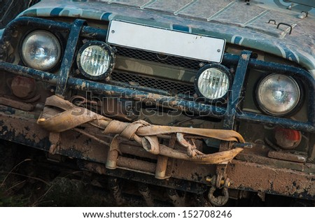 Off-road in the mud with a winch on the frame. Off road car participating in off-road rally.  - stock photo