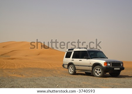 Off Road Land Rover Discovery by Sand Dunes - stock photo