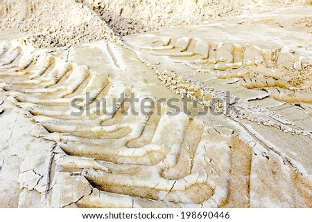 Off road tire tracks with shadow in the sand - stock photo