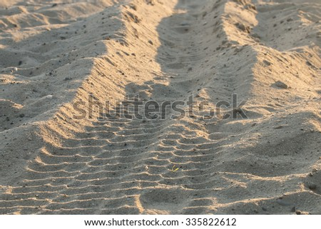 Off road tracks on the beach - stock photo