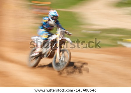 Off-rod motorbike riding fun, speed blurred motion