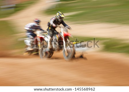 Off-rod motorbike riding fun, speed blurred motion - stock photo