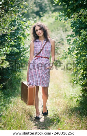 Off to elsewhere: beautiful young woman thinking about her next destination