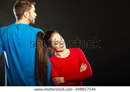 Offended upset young couple not talking to each other standing back to back after argument quarrel. Unhappy man and woman. Disagreement in relationship. - stock photo