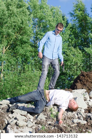 Offender gets rid of the corpse, throws off a cliff - stock photo
