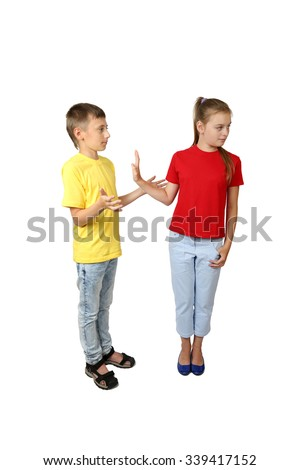 Offer and rejection gesture - teenage boy and girl in jeans and yellow and red t-shirts stand in full height isolated on white background - how to say no - stock photo