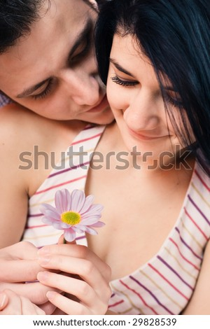 Offering a flower to his loved one - stock photo