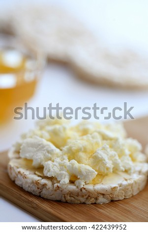offering gluten-free breakfast- rice waffles with white cheese and honey - stock photo