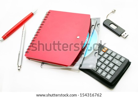 Office accessories and compact disks on a white background