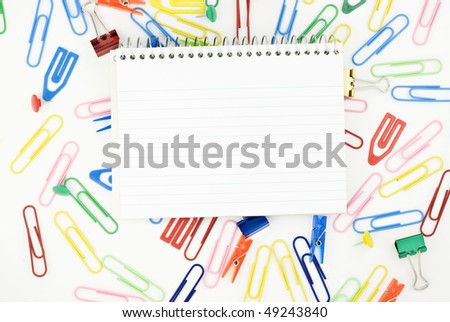 Office and School supplies background with lined spiral index cards in center, horizontal with copy space - stock photo