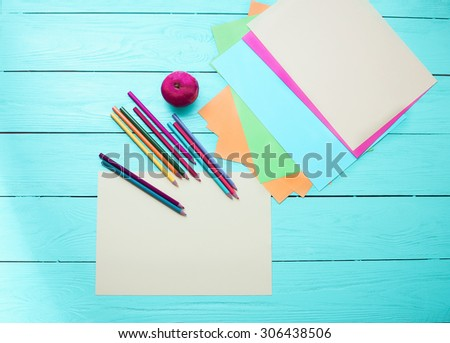 Office and student accessories on blue wooden background. Back to school concept. - stock photo