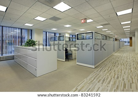 Office area with cubicles in high rise building - stock photo