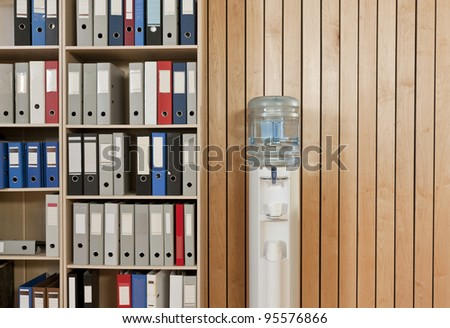Office backdrop with some folders and a watercooler - stock photo