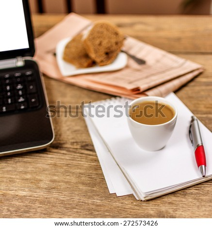 Office background with laptop coffee dessert  notepad