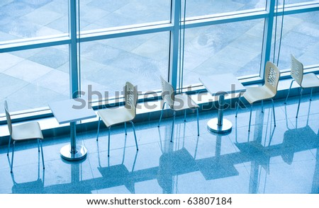 office bar with many chairs and table, blue tone. - stock photo