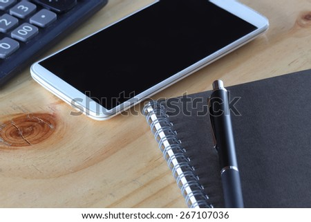Office book with a pencil and a calculator  - stock photo