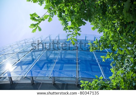 Office building and green oak, business concept - stock photo