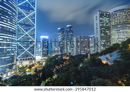 office building at night in hong kong - stock photo
