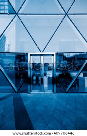 office building entrance,blue toned image. - stock photo