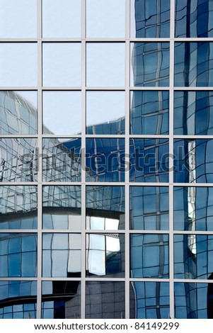 Office Building Reflections - Sails in Windows. Pattern of windows on a clear blue day.