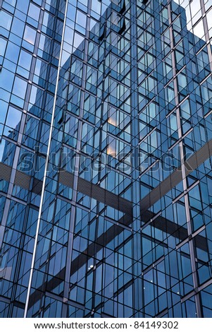 Office Building Reflections - Sails in Windows. Pattern of windows on a clear blue day. - stock photo