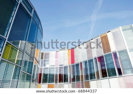 Office building with colorful glass front - stock photo