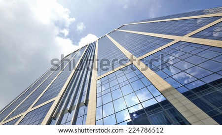 Office building with plate glass walls and gleaming steel structure. - stock photo