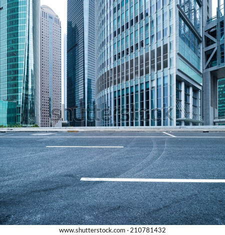 Office buildings and road at shanghai - stock photo