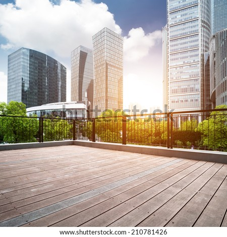 Office buildings and wooden platforms at shanghai,china - stock photo