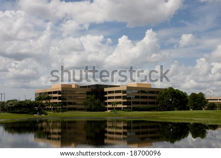Office buildings as viewed across a small lake