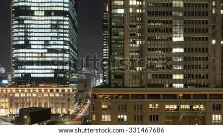 Office buildings at night, Tokyo, Japan - stock photo
