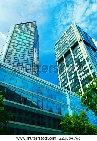 Office buildings in downtown of Frankfurt in the afternoon on a sunny day - stock photo