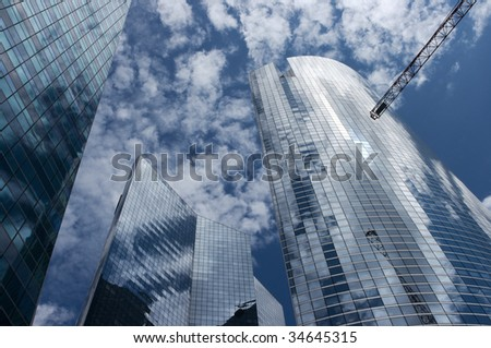 Office buildings in perspective with a crane - stock photo