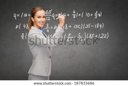 office, business and new technology concept - smiling businesswoman writing formula on concrete wall with marker