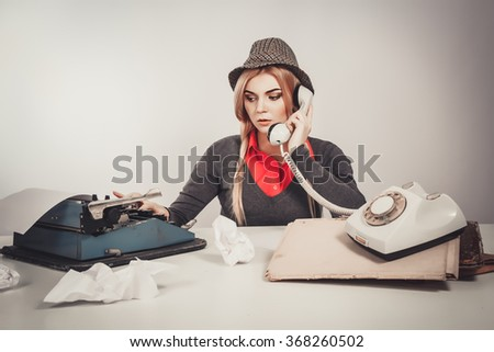 Office, business,detective concept-Beautiful retro business woman vintage secretary talking telephone on gray background - stock photo