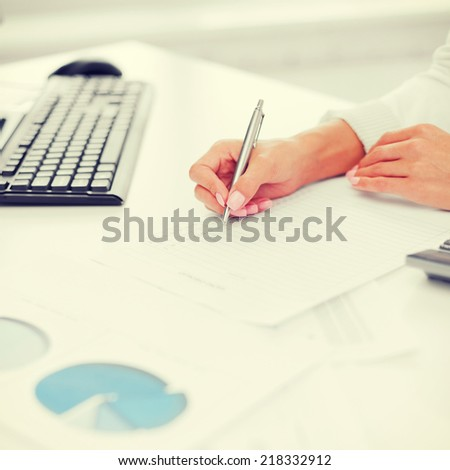 office, business, tax, accounting concept - businesswoman working with calculator in office - stock photo