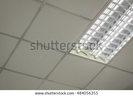 Office Ceiling. Office Ceiling With White Fluorescent Fixture Near Window.  Fluorescent Lamp On The