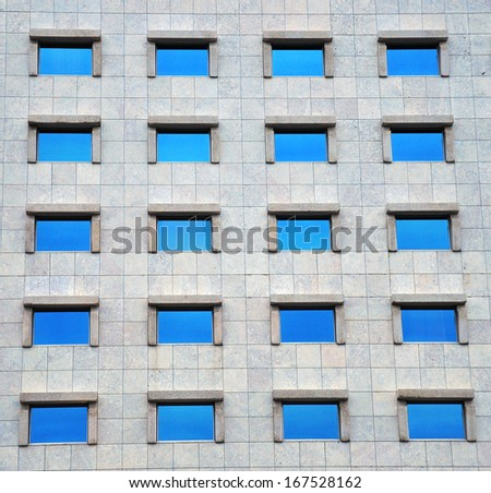 Office centre exterior: windows of a modern building - stock photo