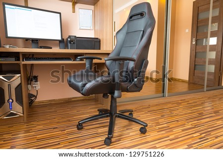 Office chair at the computer desk at home - stock photo