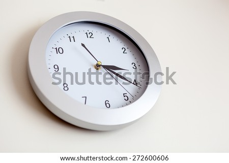 Office clock hanging on the wall. Shallow depth of field  - stock photo