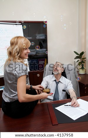 Office. Close relations. Boss and young pretty secretary has a coffee break. - stock photo