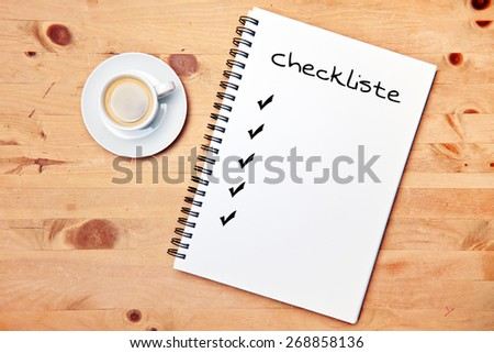 office - coffee - writing pad - german for checklist - stock photo