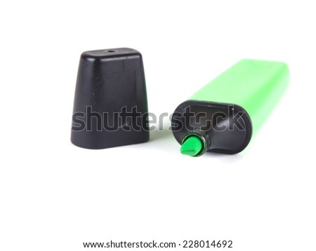office composition from a green marker on a white background - stock photo
