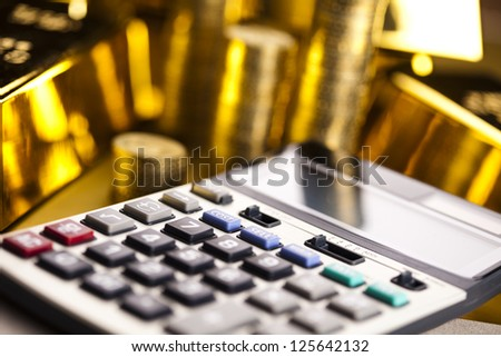 Office Concept, Gold bar and coins - stock photo