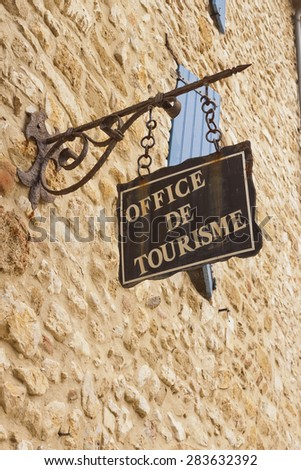 Office de Tourisme hanged sign in France, Europe.